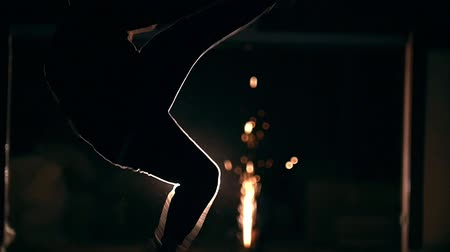 sztuki walki : Martial arts in in front of sparklers - cheat Kick somersault in the air, slow-motion Wideo