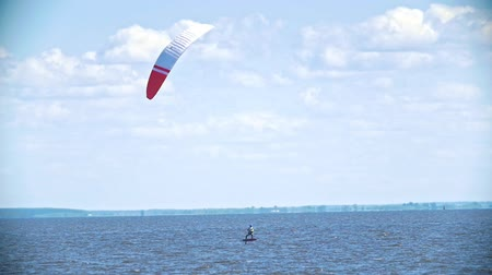 kite boarding : Man moving on the water with a sail on a kitesurf