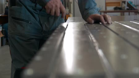 scraper : Worker with a scraper removing burrs on metal detail for cnc machinery production Stock Footage