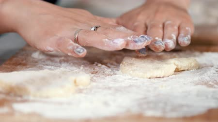 twaróg : Mother and daughter hands forming homemade pancakes from dough