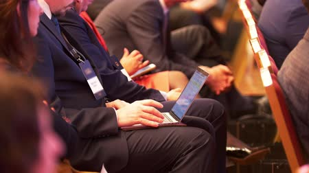 congress : Man working with laptop at a conference
