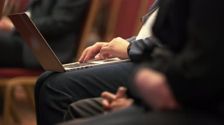 tribune : People on their seats listening and writing at business conference Stock Footage