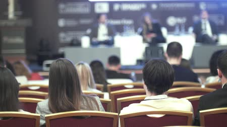 nyilvános : People on the business conference - rear view