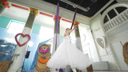 terlik : Female beautiful ballerina in white tutu performs pirouette in spacious and modern studio