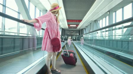 escalators : Rear view of mom and little daughter going down the escalator at the airport Stock Footage