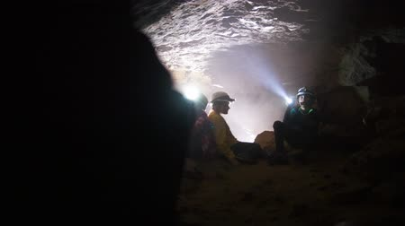 lanterna : Children resting in a cave - traveling and adventure undeground