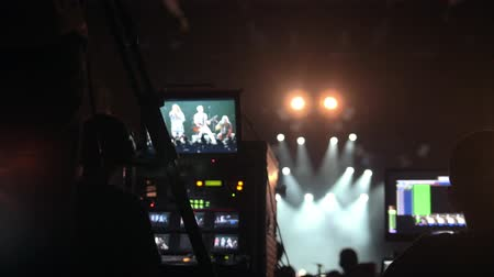 switch : Soundman works on professional sound equipment at the rock-concert