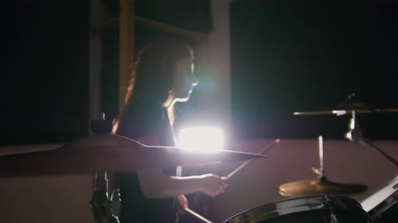 cultura juvenil : Night club music - sensual dashing girl percussion drummer perform rock