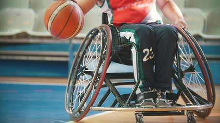 impaired : Disabled wheelchair, basketball player practice playing with tha ball in the sport hall Stock Footage