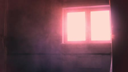 abandonar : Dust in the room during construction. Red light from window Stock Footage