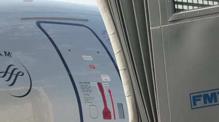 trup letadla : 15 august 2018, Moscow, Russia - The air stair is connected to the door of a white airplane