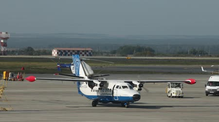 аэробус : 15 august 2018, Moscow, Russia - A small white plane with two propellers starts