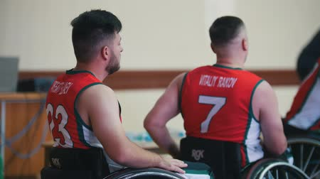 impaired : Kazan, Russia - 21 september 2018 - Wheelchair disabled basketball players shake hands during game in the gym Stock Footage