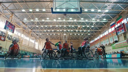 impaired : Kazan, Russia - 21 september 2018 - Disabled player scores a ball in the basket during a game of wheelchair basketball