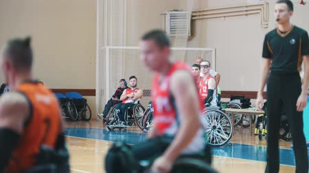 impaired : Kazan, Russia - 21 september 2018 - Spare disabled players watch the game of their teammates during a game of wheelchair basketball