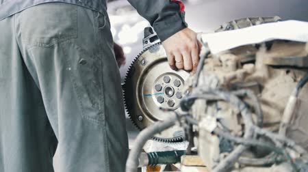 spare part : Mechanic tests the rotation of the gear box of the car