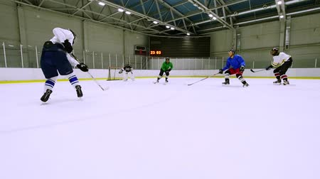 ice hockey rink : A team playing hockey on the ice during training. Slow motion.