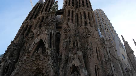 art noveau : Barcelona, Spain - September 2018: International group of tourists admiring the Sagrada Familia Church built by Antoni Gaudi - taking photos selfies with the magnificent religious architecture