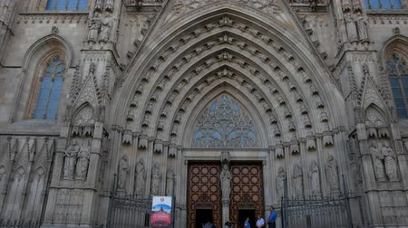 marad : Barcelona, Spain - September 2018: Unidentified people walk around square at Cathedral of the Holy Cross and Saint Eulalia, take pictures of famous Barcelona landmark
