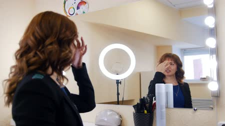 cuticle : Woman in a cosmetology clinic. Specialist working with hair. Happy client Stock Footage