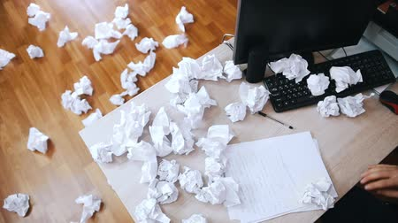 wall paper : Stressed man crosses out what is written and throws crumpled paper away from the table. Slow motion