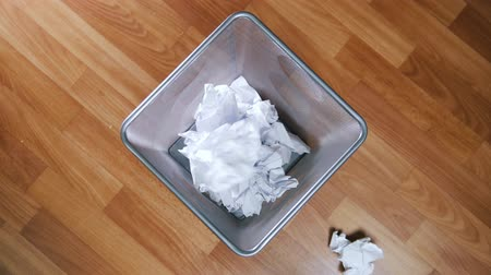 discard : An empty office trash basket gets filled up Stock Footage