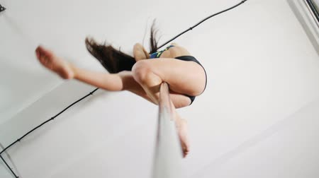танцоры : Attractive girl dancing on a pole, dancer, fitness and sport. Angle from below