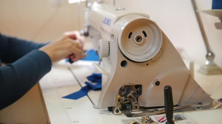 yorgan : Woman works on Sewing Machine
