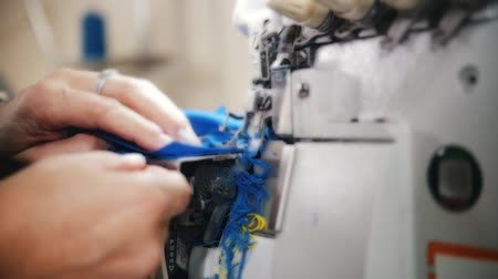 yorgan : Woman works with cloth on Sewing Machine. Slow motion shot