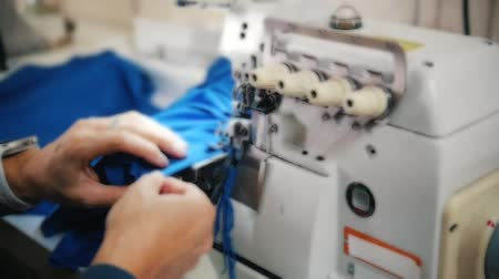 yorgan : Making clothes. Woman works with cloth on Sewing Machine. Focus on tool