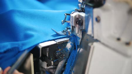 paplan : Making clothes. Woman works with textile on Sewing Machine. Focus on cloth