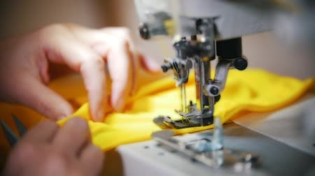 yorgan : Making clothes. Female hands work on Sewing Machine. Slow motion shot Stok Video