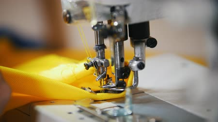 paplan : Making clothes. Female hands work on Sewing Machine. Stock mozgókép