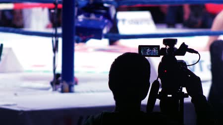 adversidade : Blurred view of boxers legs on the ring. Cameraman recording. Static