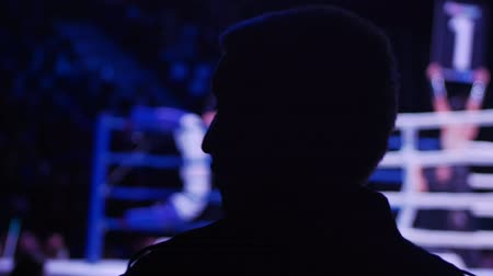 adversidade : A silhouette of a man watching the box battle Stock Footage