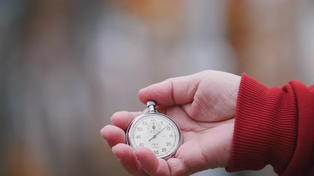 pocket watch : An old woman is holding a pocket watch. Close up Stock Footage
