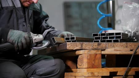 metal işi : Industrial factory. Polishing rectangular metal pieces. Slow motion
