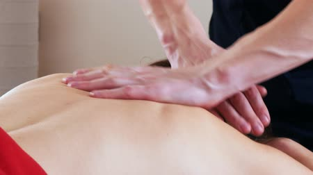 closed : Massage session. Young woman receiving relaxing massage. Back