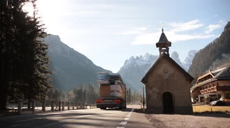 nákladní auto : DOLOMITES, ITALY - NOVEMBER 11, 2018 - A truck drove past the building on the way to the Dolomites Dostupné videozáznamy