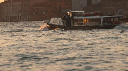 ferryboat : Passenger boat for water transportation at canal in sunset back light, popular tourist journey. Sunset Stock Footage