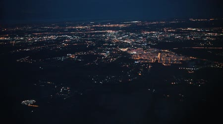 asa : Big city top view from above. Lights of the street. View from the airplane window.