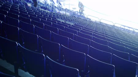 вратарь : Preparing for a hockey match. Empty tribunes