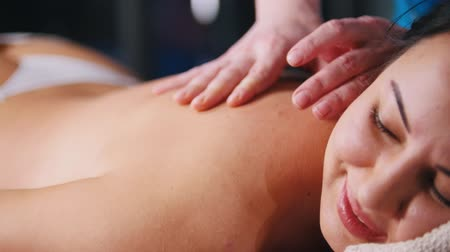 terapeuta : Massage treatment. A woman client lays on the couch and receiving the massage. Close up