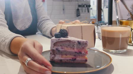 kaplanmış : Bakery. Serving piece of blackberry cake and cup of coffee to a client
