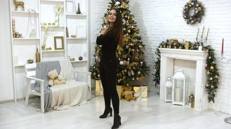 peluş : A young woman model in braces in the photo studio. Christmas theme. Looking around and looks excited