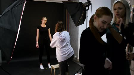 oturum : RUSSIA, KAZAN. 14-12-2018: Young woman models having a photo session in the studio. Stok Video