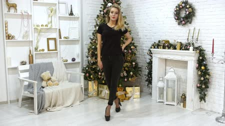 peluş : A young blonde woman model in the photo studio. Christmas theme. Posing for the camera Stok Video