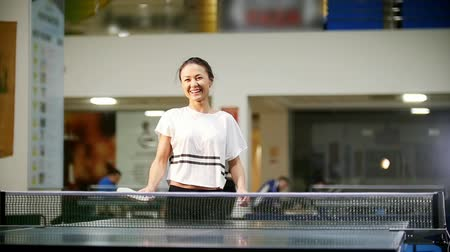 teniszütő : Ping pong playing. Young smiling woman playing table tennis