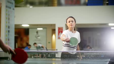 nem sikerül : Ping pong playing. Young woman playing table tennis. Her opposer fails and she throws up her hands