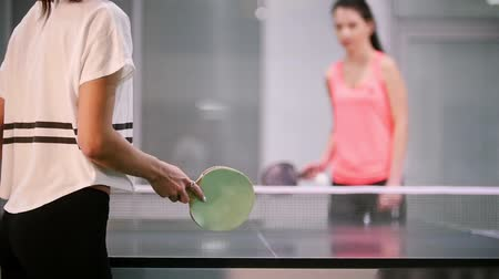 подача : Ping pong playing. Young woman innings the ball. Playing Стоковые видеозаписи